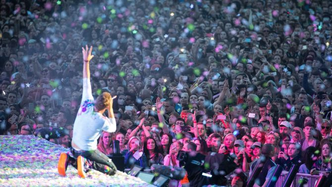 Coldplay frontman Chris Martin delights the Manchester crowd.
